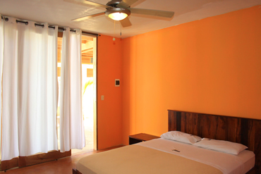 The matrimonial rooms have a spacious queen bed.
