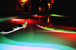 The night ambience at Kites Mancora fills with the colors provided by the colorful pool lighting